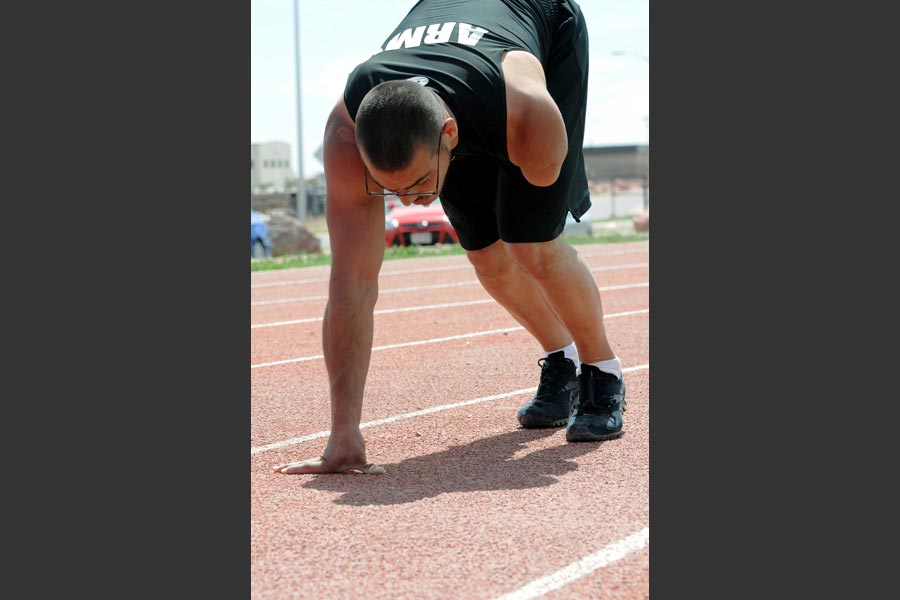 Retired Army Staff Sergeant Michael Kacer, prepares to run laps during track practice at McKibben Physical Fitness Center