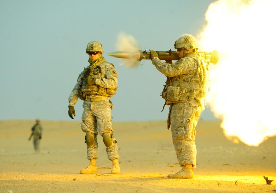 Private First Class Matthew Carpenter, assigned to 3rd Infantry Division, fires an AT-4, an anti-tank weapon, near Camp Buehring, Kuwait