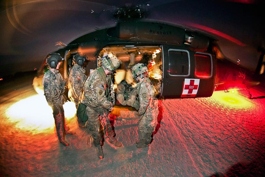 Medics with 82nd Airborne Division  retrieve notionally-wounded paratroopers from Black Hawk medevac helicopter