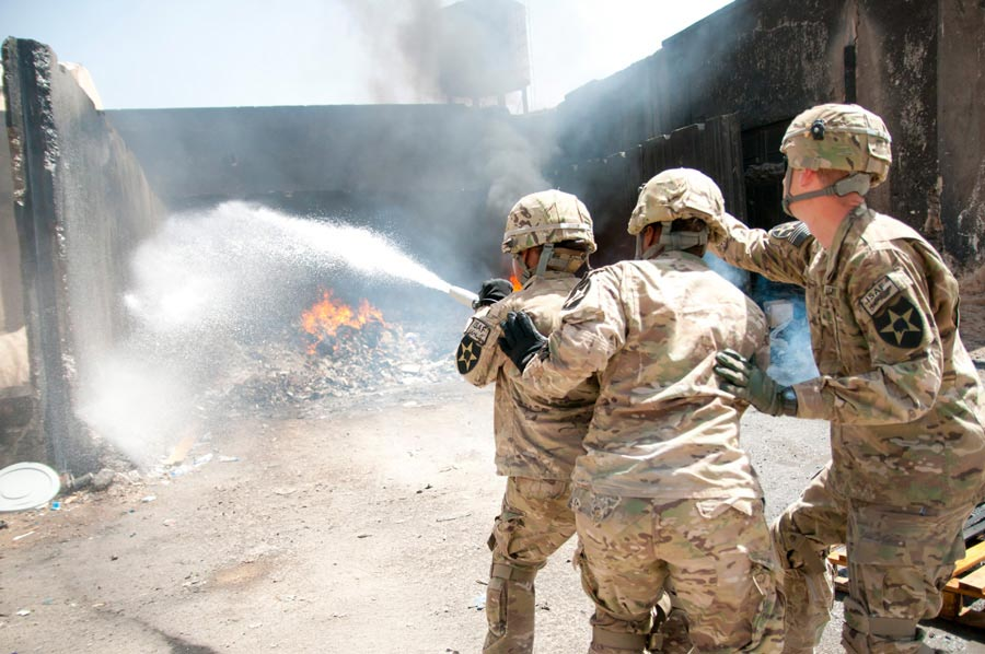 Corporal William Lamm, 2nd Infantry Division, directs Soldiers during an incipient fire exercise