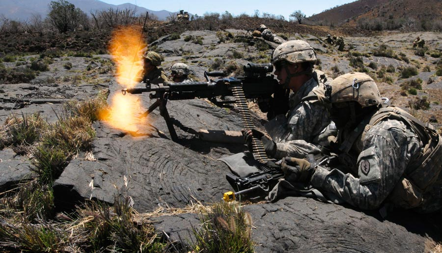 Soldiers from 25th Infantry Division, provide suppressive fire on target during training exercise