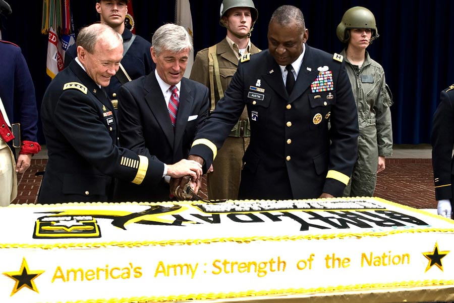 General Martin E. Dempsey, joined John M. McHugh, and General Lloyd Austin, celebrating the Army's 237th birthday