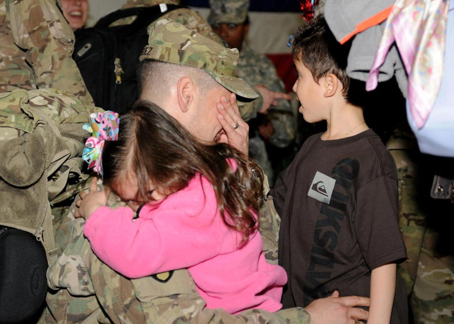 Soldiers from XVIII Airborne Corps, are greeted by family and friends as they return from year-long deployment