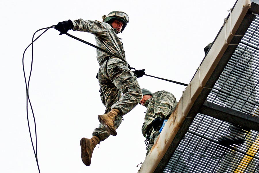 Missouri National Guardsman Cadet Andrew Cully leaps from top of rappel tower
