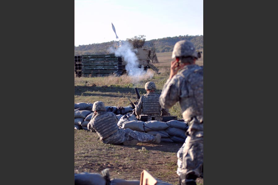 Mortar men with 2nd Infantry, launch mortar during combined-arms field training exercise
