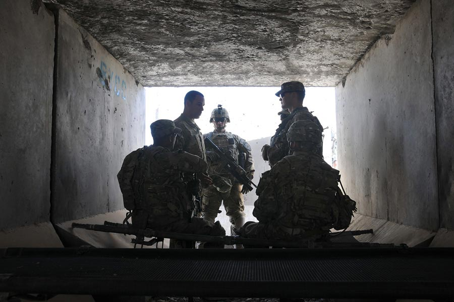 Soldiers of 2nd Infantry Division, receive briefing in bunker at Combat Outpost Khenjakak, Afghanistan
