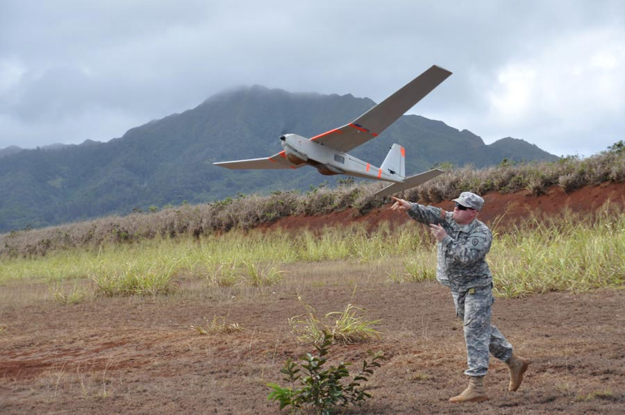 Sergeant Michael Tacket, with 25th Infantry Division, launches Tier I Small Unmanned Aerial Vehicle 'PUMA,' during training
