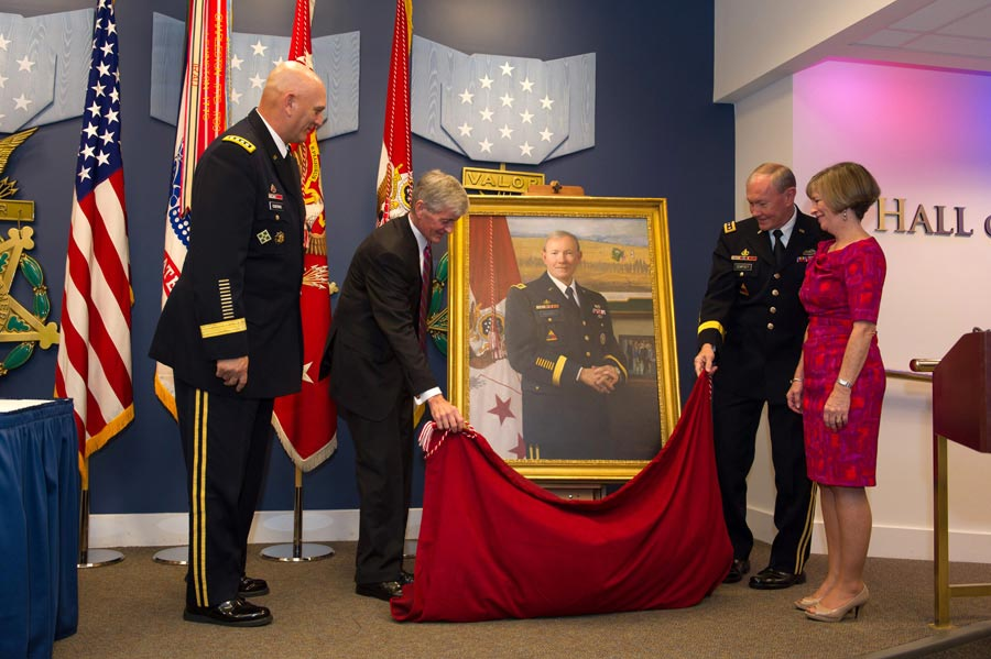 General Raymond T. Odierno, John McHugh, General Martin E. Dempsey, and wife Deanie unveil Dempsey's portrait during ceremony at Hall of Heroes in Pentagon