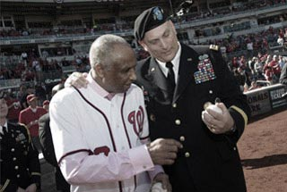 Army Chief of Staff General Raymond T. Odierno shows baseball to Hall of Famer Frank Robinson
